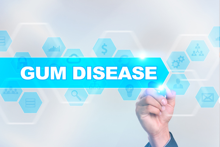 Medical doctor drawing gum disease on the virtual screen. Stock Photo