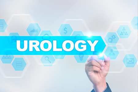 urologist: Medical doctor drawing urology on the virtual screen. Stock Photo