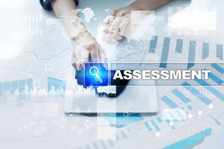 assessments: Woman working with documents, tablet pc and selecting assessment.