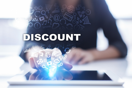 Woman is using tablet pc, pressing on virtual screen and selecting discount.
