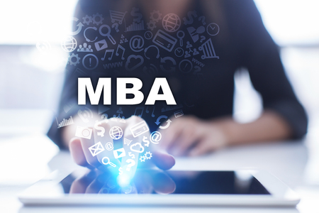 Woman is using tablet pc, pressing on virtual screen and selecting mba. Stock Photo