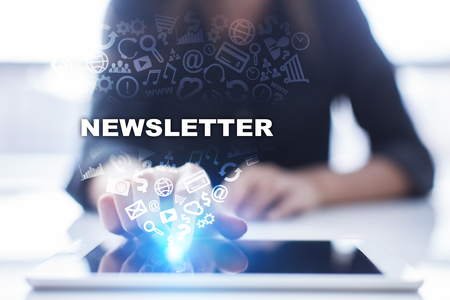 Woman is using tablet pc, pressing on virtual screen and selecting newsletter.