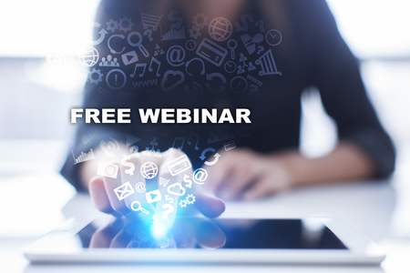 Woman is using tablet pc, pressing on virtual screen and selecting free webinar.