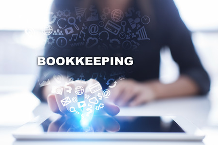 contaduria: Woman is using tablet pc, pressing on virtual screen and selecting bookkeeping.