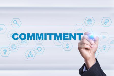 Businessman drawing on virtual screen. commitment concept. 版權商用圖片
