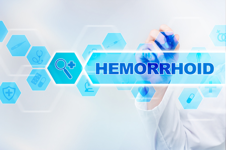 hemorrhoid: Medical doctor drawing hemorrhoid on the virtual screen.