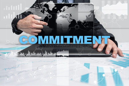 commit: Businessman presenting commitment concept.