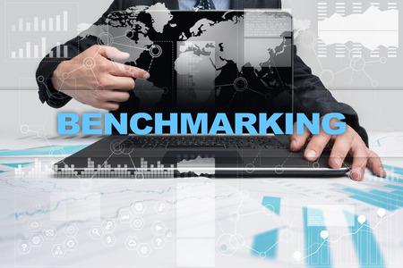 Businessman presenting benchmarking concept. Stock Photo