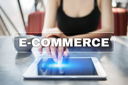 e commerce: Woman using tablet pc and selecting e-commerce.