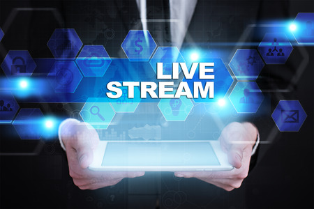 live stream radio: Businessman holding tablet PC with live stream concept. Stock Photo