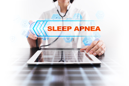 somnambulism: Medical doctor using tablet PC with sleep apnea medical concept.