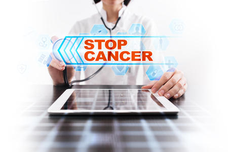 Medical doctor using tablet PC with stop cancer medical concept.