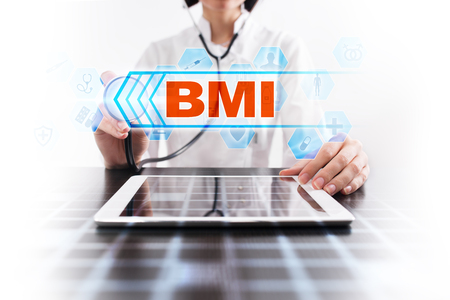 Medical doctor using tablet PC with bmi medical concept.