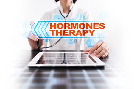 Medical doctor using tablet PC with hormones therapy medical concept. Stock Photo