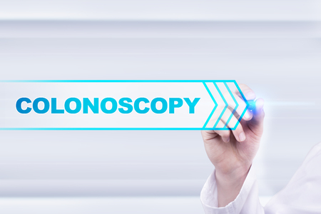 colonoscopy: Medical doctor drawing colonoscopy on the virtual screen. Stock Photo
