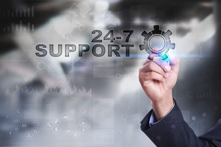 24x7: Businessman is drawing on virtual screen. 24-7 support concept.