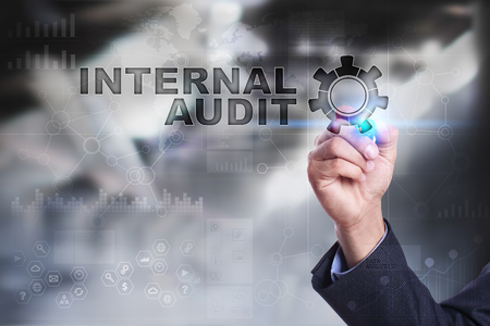 registros contables: Businessman is drawing on virtual screen. internal audit concept.