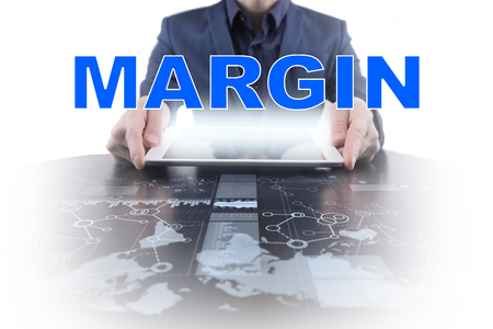 marginal: Businessman working with modern tablet PC and presenting margin concept.