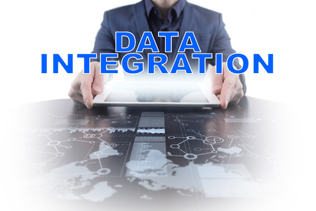 Businessman working with modern tablet PC and presenting data integration concept. Stock Photo