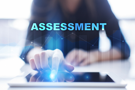 assessments: Woman using tablet pc and selecting assessment.
