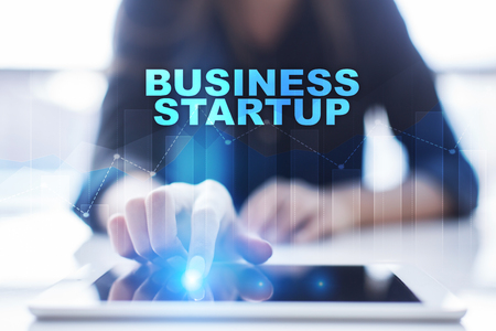 Woman using tablet pc and selecting business startup. Stock Photo
