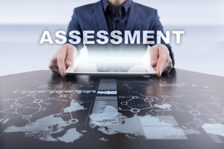 assessments: Businessman using tablet pc and selecting assessment.