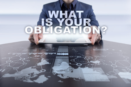 obligated: Businessman using tablet pc and selecting what is your obligation. Stock Photo