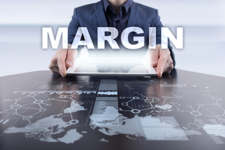 marginal: Businessman using tablet pc and selecting margin.