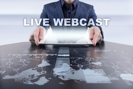 live stream radio: Businessman using tablet pc and selecting live webcast.