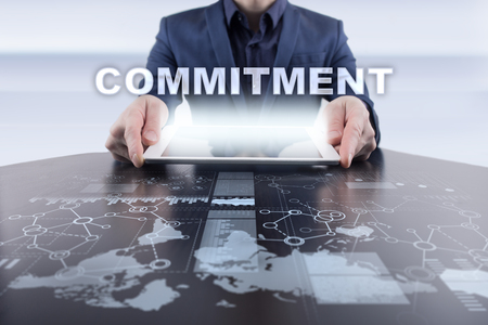 commit: Businessman using tablet pc and selecting commitment.