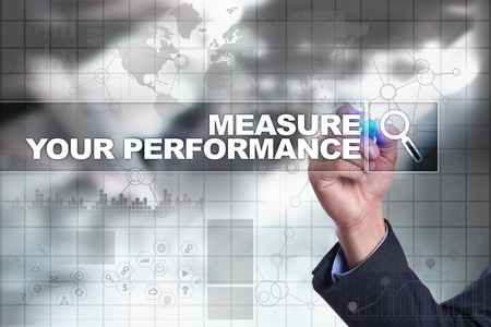 Businessman drawing on virtual screen. measure your performance concept.