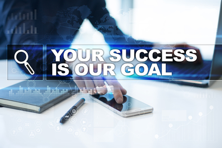 Businessman working in office, pressing button on virtual screen and selecting your success is our goal.