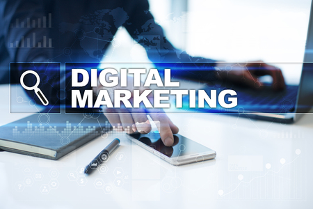 Businessman working in office, pressing button on virtual screen and selecting digital marketing.