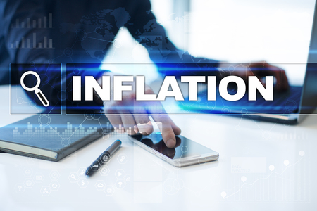 Businessman working in office, pressing button on virtual screen and selecting inflation. Stock Photo