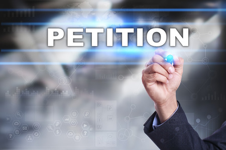 Businessman is drawing on virtual screen. petition concept.