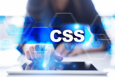 Woman using tablet pc, pressing on virtual screen and selecting css.