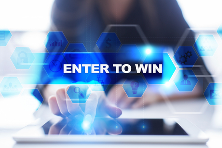 Woman using tablet pc, pressing on virtual screen and selecting enter to win.