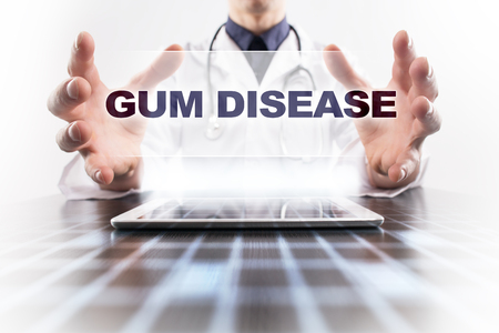 word of mouth: Medical doctor using tablet PC with gum disease medical concept.