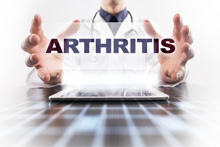 spondylitis: Medical doctor using tablet PC with arthritis medical concept. Stock Photo