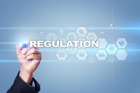 gobierno corporativo: Businessman drawing on virtual screen. regulation concept. Foto de archivo