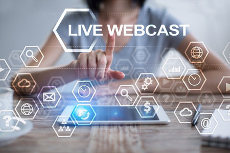 live stream tv: Woman using tablet pc, pressing on virtual screen and selecting live webcast. Stock Photo