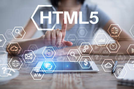 Woman using tablet pc, pressing on virtual screen and selecting html5.