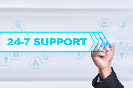 24x7: Businessman drawing on virtual screen. 24-7 support concept. Stock Photo