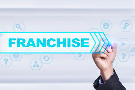 franchising: Businessman drawing on virtual screen. franchise concept.