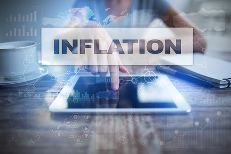 Woman using tablet pc, pressing on virtual screen and selecting inflation. Imagens