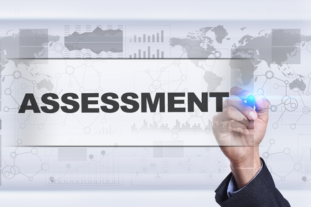 assessments: Businessman drawing on virtual screen. assessment concept. Stock Photo