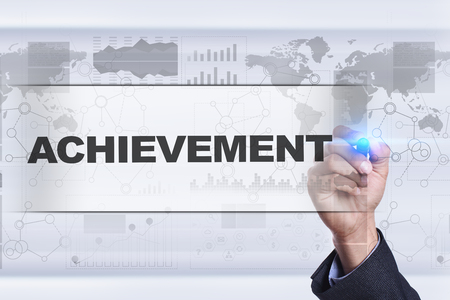 achivement: Businessman drawing on virtual screen. achievement concept.