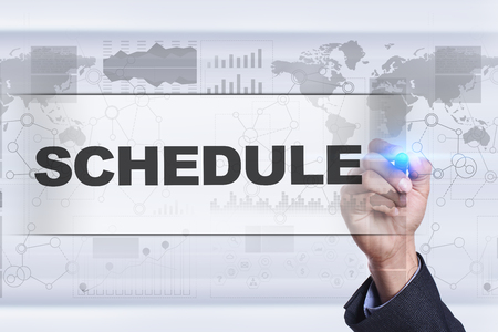university application: Businessman drawing on virtual screen. schedule concept. Stock Photo