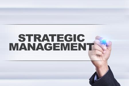 strategic focus: Businessman drawing on virtual screen. strategic management concept.