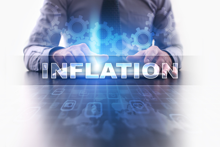 Businessman working with modern tablet pc and selecting inflation. Imagens